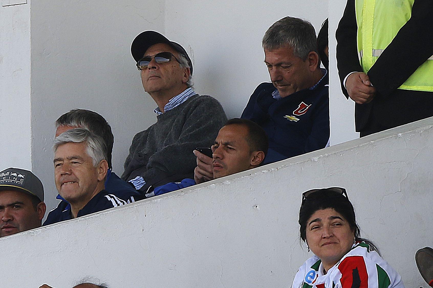 Díaz y Carlos Heller viendo un partido de Universidad de Chile
